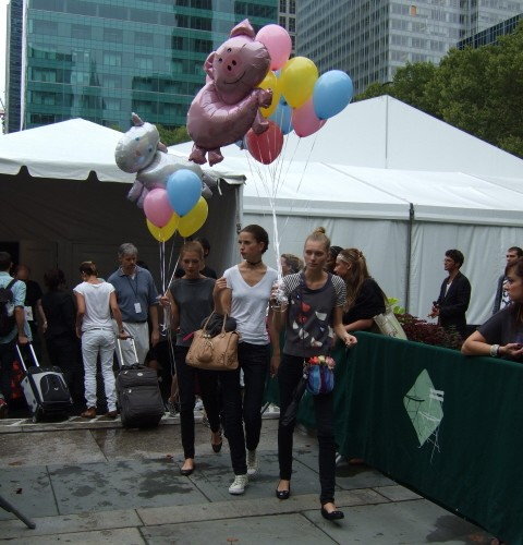 models Outside Mercedes-Benz Fashion Week in Bryant Park after Betsey Johnson show