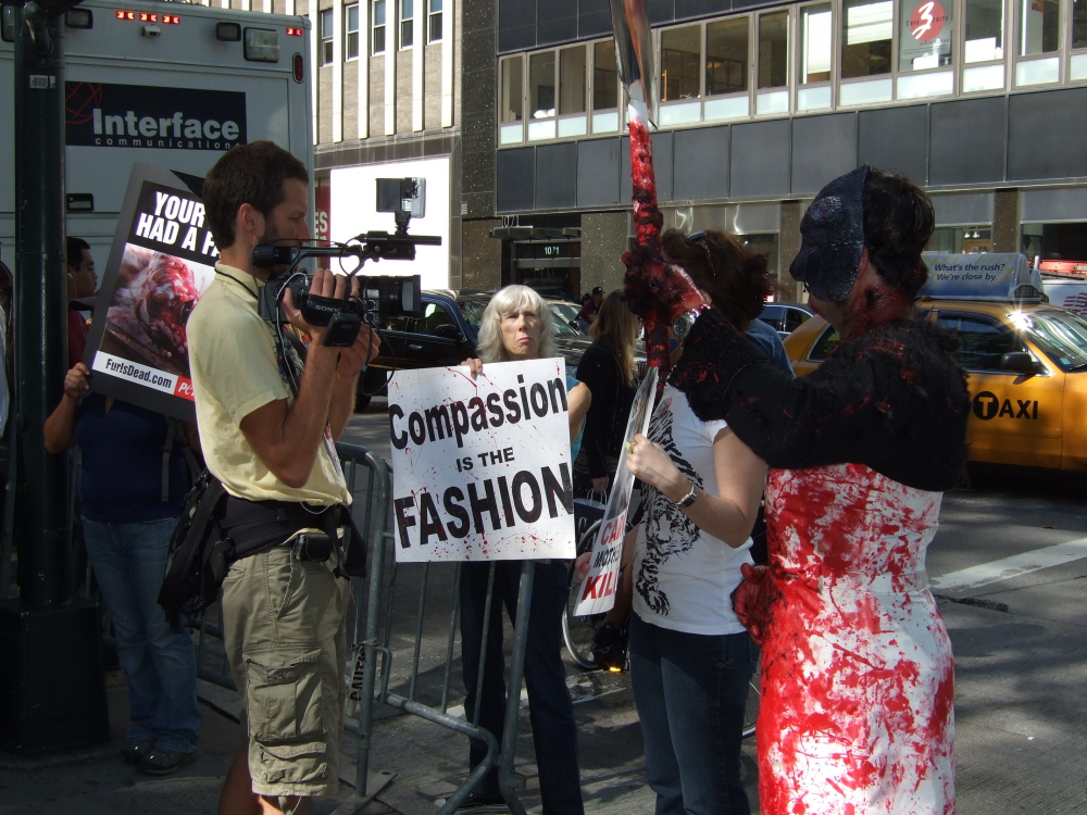 protesters outside of Carolina Herrera fashion show