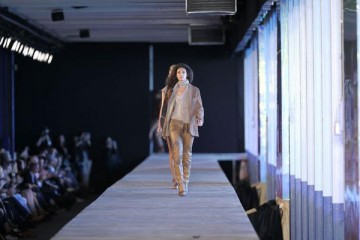 Model walking on runway
