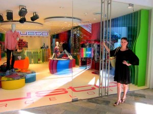 Photo of Kristen Colapinto in front of the Custo Barcelona store in Aruba.