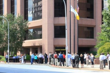 Office workers Gather Outside Their Building in White Plains, NY after East Coast Earthquake